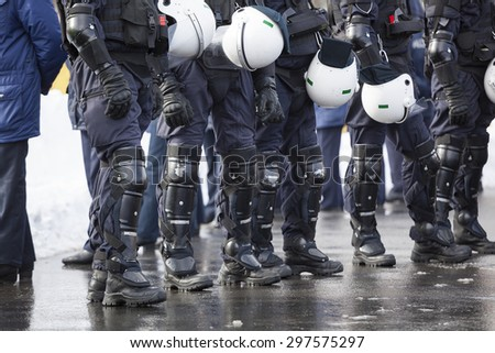 Riot Police unit waiting for orders - stock photo