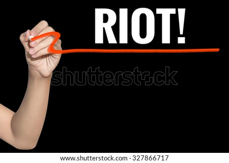 Riot word write on black background by woman hand holding highlighter pen - stock photo