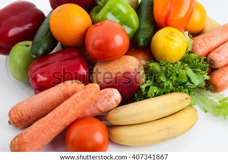 Ripe and fresh fruits and vegetables laying on the table - stock photo