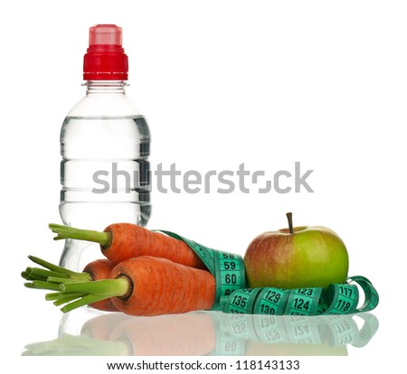 Ripe apple with raw carrot, tape measure and bottle of water isolated over white - stock photo