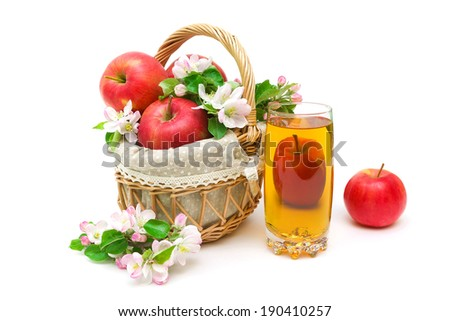ripe apples, a glass of juice and apple flowers on a white background close-up. horizontal photo. - stock photo