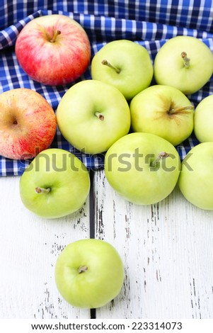 Ripe apples on wooden table close-up - stock photo