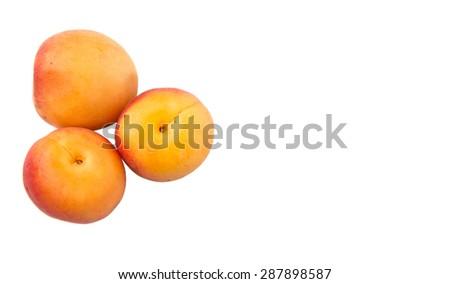 Ripe apricot over white background - stock photo