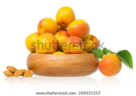 Ripe apricots in a bamboo plate isolated on a white background - stock photo