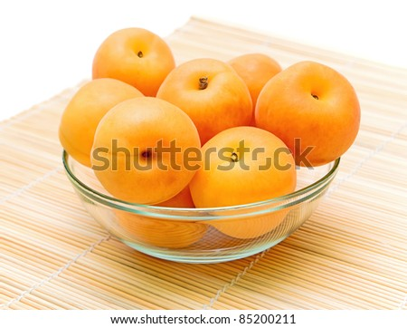 ripe apricots in a glass bowl closeup - stock photo
