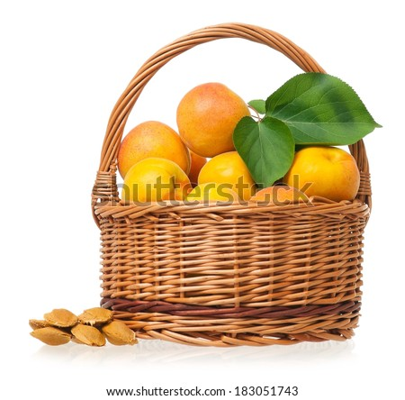 Ripe apricots in a wicker basket isolated on a white background - stock photo