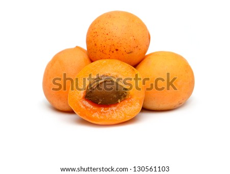 ripe apricots on a white background - stock photo