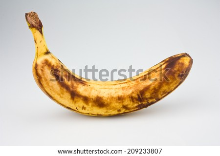 Ripe Banana With Brown Spots - stock photo