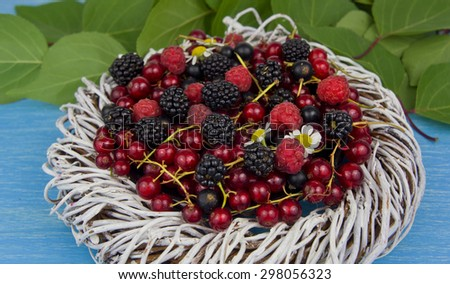 ripe berries on a wooden table - blackberries, raspberries and currants - stock photo
