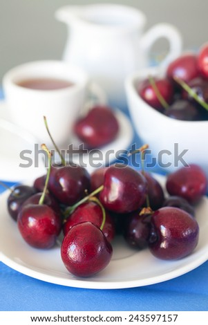 Ripe cherries in a bowl. - stock photo