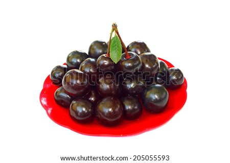 Ripe cherries in a small red platter                                - stock photo
