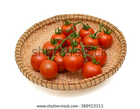 ripe cherry tomatoes fruits in basket isolated on white background - stock photo
