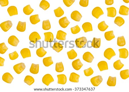 Ripe corn isolated. A few grains of canned corn on a white background. Sweet whole kernel corn - stock photo