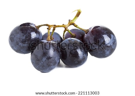 Ripe dark grapes with leaves, Isolated on white background - stock photo