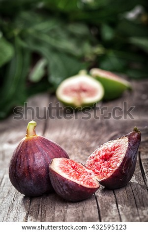 Ripe fig splitted in half - stock photo