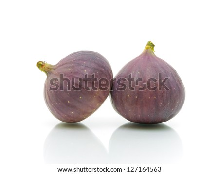 ripe figs close up isolated on white background - stock photo