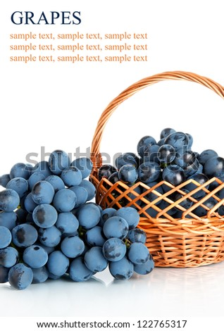 Ripe fresh  grapes  in wicker basket, isolated on white background - stock photo