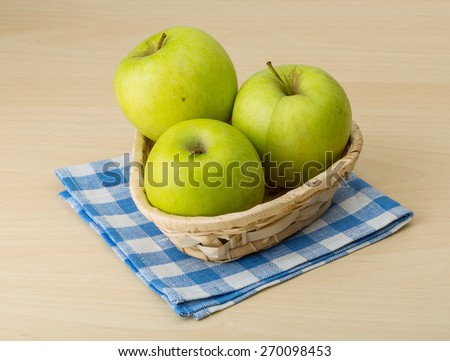 Ripe fresh Green apples on the wood background - stock photo