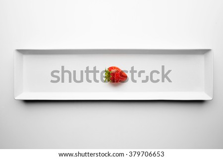 Ripe fresh juicy strawberry isolated on rectangular ceramic plate on white table background. Restaurant serving - stock photo
