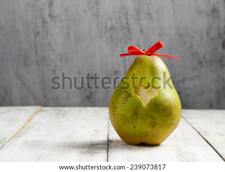 Ripe fresh pear with heart for Valentine day - stock photo