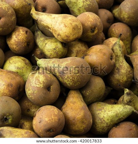Ripe fresh pears for sale on the market - stock photo