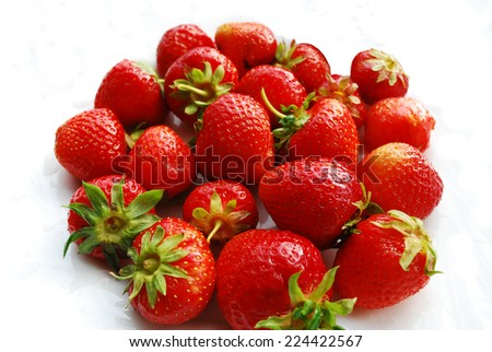 Ripe fresh strawberries on a white background.  - stock photo