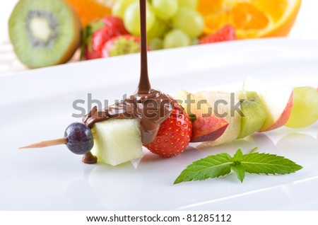 Ripe fruit in season with milk chocolate coating - stock photo