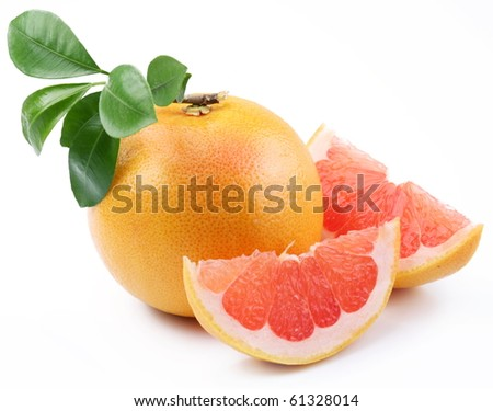 Ripe grapefruit with leaves and slices on white background - stock photo