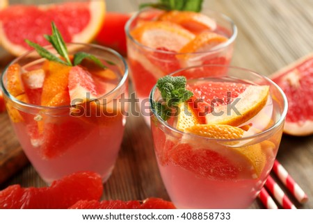 Ripe grapefruits and fresh juice with mint, close up - stock photo