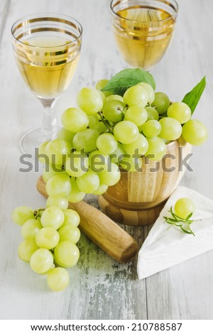 ripe grapes, brie cheese and wine in wine glasses. healthy food.traditional food - stock photo