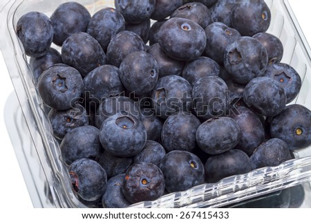 Ripe great bilberry in the box  isolated on white background - stock photo