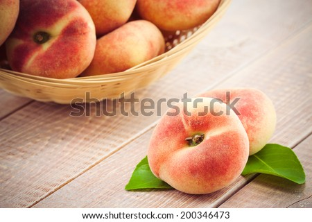 ripe juicy chinese flat peaches or Saturn peaches - stock photo