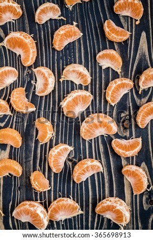 Ripe juicy mandarin fruits on blue wooden background - stock photo