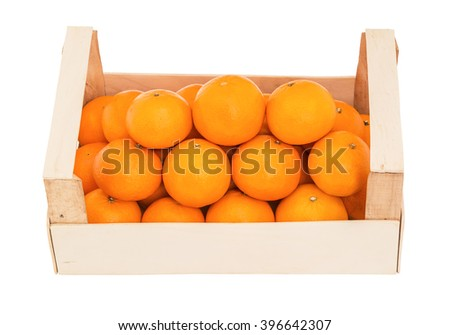Ripe, juicy tangerines in a wooden box stacked as pyramid, on a white background. Front view - stock photo