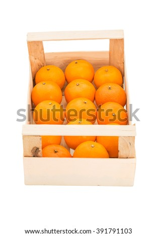 Ripe, juicy tangerines in a wooden box, stacked in a one row and photographed on a white background - stock photo