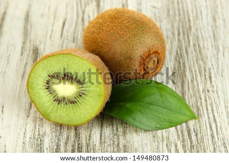 Ripe kiwi on wooden table close-up - stock photo