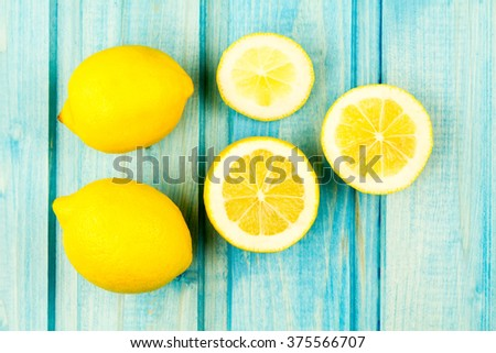 Ripe lemon fruit on wooden vintage background. Healthy vegetarian food. Recipe, menu, mock up, cooking. - stock photo