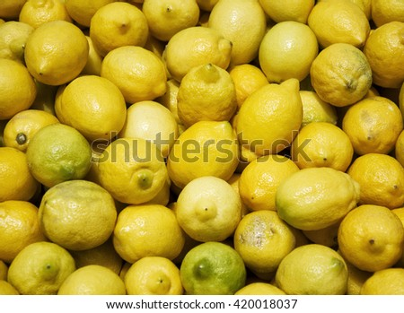 Ripe lemons close-up on Saturday market - stock photo