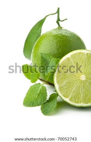 Ripe lime with green leaf and mint. Closeup, isolated on white - stock photo