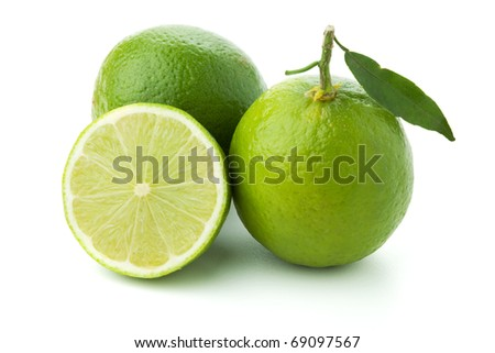 Ripe limes with green leaf. Isolated on white - stock photo