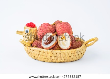 Ripe lychee fruit in hen basket against white background - stock photo