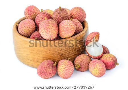 Ripe lychee fruit in wooden bowl against white background - stock photo