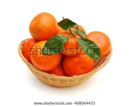 Ripe mandarin citrus isolated tangerine mandarine orange in basket on white background.  - stock photo
