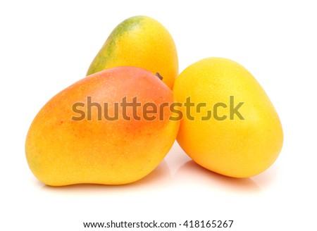 Ripe mango fruits isolated on white background - stock photo