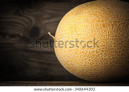 Ripe melon on the wooden table horizontal - stock photo