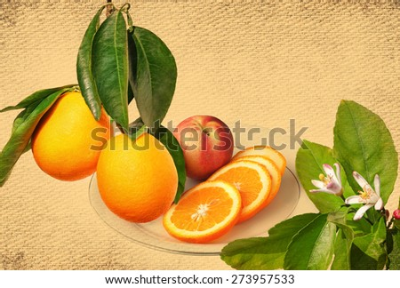 Ripe orange fruits on a branch, citrus flowers on the tree and orange fruit sliced on a the plate ready for eating. Vintage tone canvas fabric textured background - stock photo