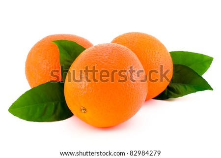 Ripe orange with green leaves. - stock photo