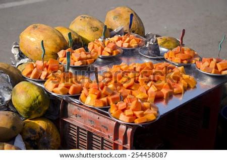 ripe papaya fruit in asian street market, India - stock photo