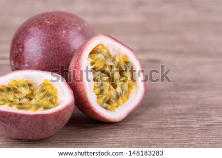 Ripe passion fruit on a wooden background - stock photo