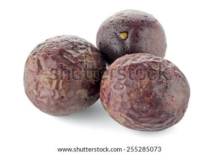 Ripe passion fruits on white background. - stock photo